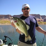 Dennis with 4# Lake Powell Largemouth This picture is on the cover of the Utah Fishing Regs 2009
